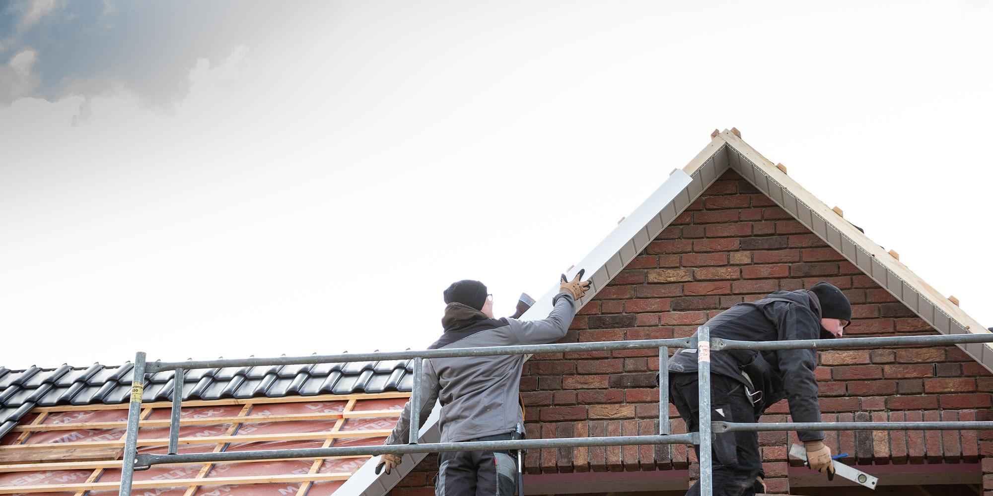 Arbeiter der EBB welche an einem Haus Arbeiten