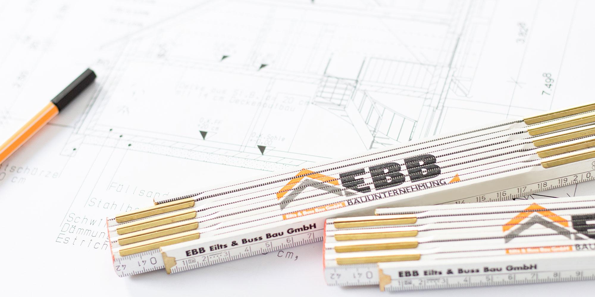 Zollstock mit Hausplan